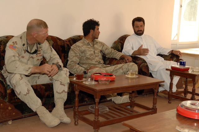 U.S. Army Command SGT. MAJ. Jeffery Hof, 1ST Battalion, 508th Infantry, and his interpreter, center, attend a meeting with governor of Paktika province, Gulab Mangal, right, in Sharan, Afghanistan, Sept. 18, 2005.  The meeting is taking place at the governor's compound in Sharan, and the topic of discussion is the ongoing parliamentary elections in Afghanistan.  (U.S Army photo by PFC. Michael Zuk)  (Released)