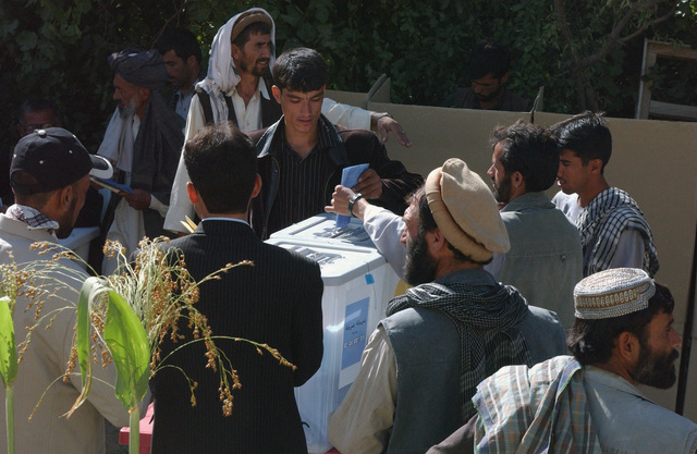 Voters in the Habdullma Lek Village vote during Afghanistan's first parliamentary elections and during Operation ENDURING FREEDOM