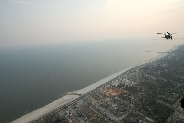 [Hurricane Katrina] Gulfport, MS., 9/19/2005 -- An Air Force helicopter flys over the Biloxi/Gulfport coast after a Congressional tour of damages in Mississippi and Louisianna by Hurricane Katrina.  Andrea Booher/FEMA