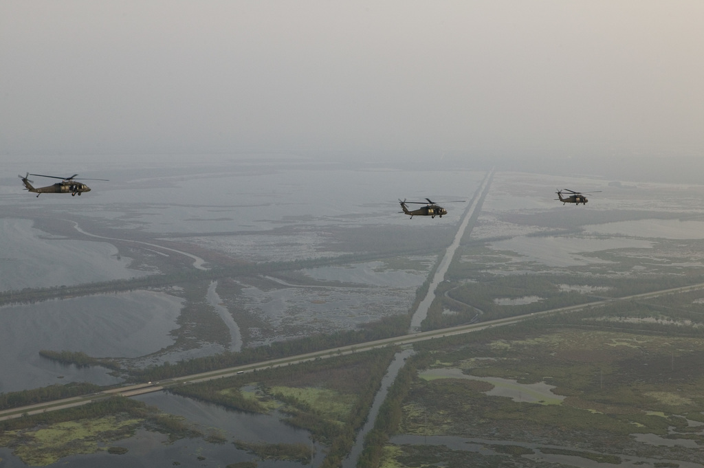 [Hurricane Katrina] New Orleans LA., 9/19/2005 -- Three Air Force helicopters return to New Orleans after a Congressional aerial tour of damages in Mississippi and Louisianna following Hurricane Katrina. Aerialooher/FEMA