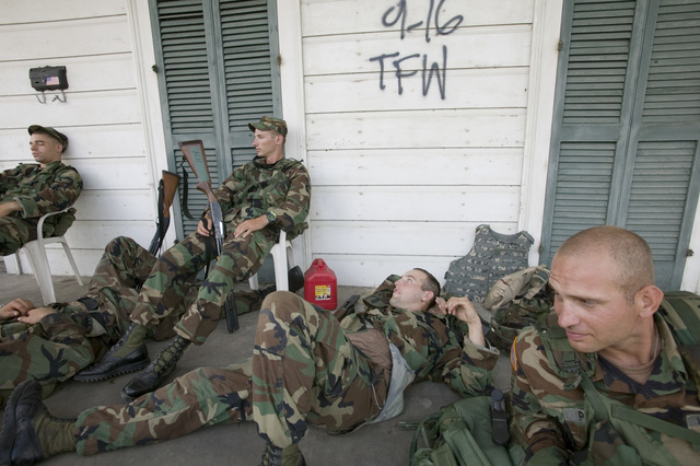 [Hurricane Katrina] Bywater, LA, 9/20/2005 -- Exhausted National Guardsmen take a break from patroling isolated communities around New Orleans. Only residents and emergency workers are allowed access following Hurricane Katrina   Andrea Booher/FEMA