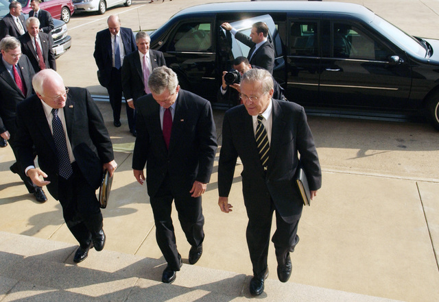 Arriving at the Pentagon in Washington, D.C. are from left to right, Vice President Richard B. Cheney, President George W. Bush and The Honorable Donald H. Rumsfeld, U.S. Secretary of Defense,  on Sept. 22, 2005.  President Bush spoke to reporters after receiving a briefing at the Pentagon, about the U.S. war effort and also urged people to follow evacuation instructions as Hurricane Rita barrels toward the Gulf Coast of Texas.  (DoD photo by TECH. SGT. Kevin J. Gruenwald) (Released)