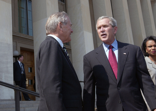 National Security advisor Condoleezza Rice (right) looks on as President George W. Bush and The Honorable Donald H. Rumsfeld, U.S. Secretary of Defense,  (left), discuss Bush's visit to the Pentagon on Sept. 22, 2005.  President Bush spoke to reporters after receiving a briefing at the Pentagon, about the U.S. war effort and also urged people to follow evacuation instructions as Hurricane Rita barrels toward the Gulf Coast of Texas.  (DoD photo by TECH. SGT. Kevin J. Gruenwald) (Released)