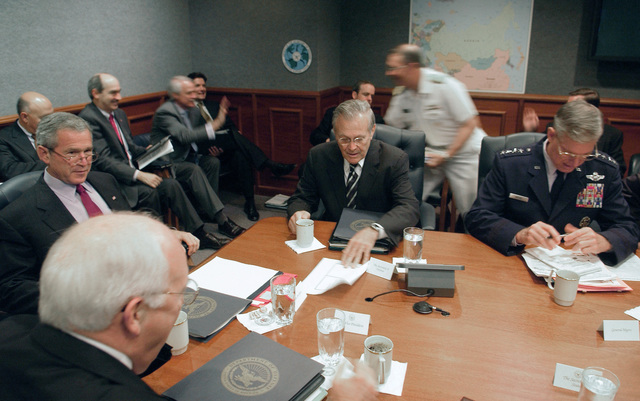 President George W. Bush (left), receives a Pentagon briefing on national policy issues from Vice President Richard B. Cheney (front), The Honorable Donald H. Rumsfeld, U.S. Secretary of Defense,  (center) and Chairman of the Joint Chiefs of STAFF GEN. Richard B. Myers, U.S. Air Force, on Sept. 22, 2005.  President Bush spoke to reporters after receiving a briefing at the Pentagon, about the U.S. war effort and also urged people to follow evacuation instructions as Hurricane Rita barrels toward the Gulf Coast of Texas.  (DoD photo by TECH. SGT. Kevin J. Gruenwald) (Released)