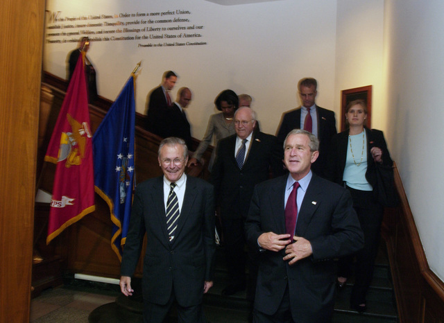 The Honorable Donald H. Rumsfeld, U.S. Secretary of Defense,  (left), escorts President George W. Bush (right), Vice President Richard B. Cheney (center) and National Security Advisor Dr. Condoleezza Rice out of the Pentagon, in Washington, D.C., after a press briefing on Sept. 22, 2005.  President Bush spoke to reporters after receiving a briefing at the Pentagon, about the U.S. war effort and also urged people to follow evacuation instructions as Hurricane Rita barrels toward the Gulf Coast of Texas.  (DoD photo by TECH. SGT. Kevin J. Gruenwald) (Released)