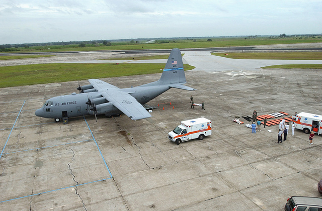 US Air Force (USAF) Aeromedical Technicians assigned to the 156th Aeromedical Evacuation Squadron (AES), North Carolina Air National Guard (NCANG) load elderly Hurricane Rita evacuees onto a USAF C-130 Hercules aircraft at Sebring Airport, in Florida (FL), in preparation from a flight back to Key West, during Hurricane Rita humanitarian assistance operations, Joint Task Force (JTF) Rita
