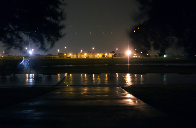 The munitions storage building lit up in the rain at night as Hurricane Rita bears down on the 147th Fighter Wing (FW), Ellington Field (FLD), Texas (TX)