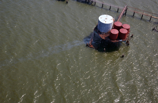An aerial view of an oil leak from the equipment placed in the Jones Bay area, during the Joint Task Force Rita hurricane relief effort. The location is just outside of Texas City, Texas (TX)