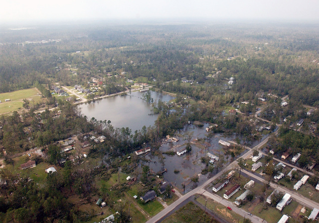 An aerial view showing houses sitting in floodwaters, downed power lines, destruction and debris left in the aftermath of Hurricane Rita, to an area north of Beaumont, Texas (TX)