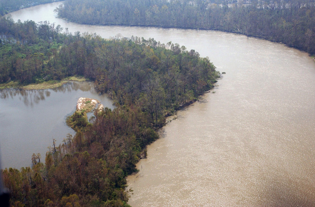An aerial view showing water levels receding in what appears to be the Neches River (possibly the Red River) in the aftermath of Hurricane Rita, to an area north of Beaumont, Texas (TX)
