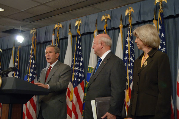 President George Bush at podium, with Energy Secretary Samuel Bodman and Interior Secretary Gale Norton to his right, giving press conference, at Department of Energy, concerning the impact of Hurricanes Katrina and Rita on oil, natural gas production, refining, distribution in Gulf of Mexico region