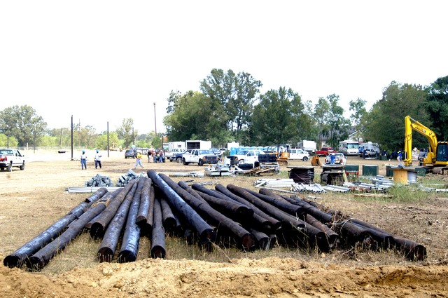 [Hurricane Katrina] Baker, La., September 26, 2005 - Line poles, connectors and other materials needed to build a 550 unit FEMA travel trailer park outside the town are stockpiled and ready to be put into place.  FEMA is constructing temporary housing parks at selected location to house those left homeless by Hurricane Katrina.  Win Henderson / FEMA