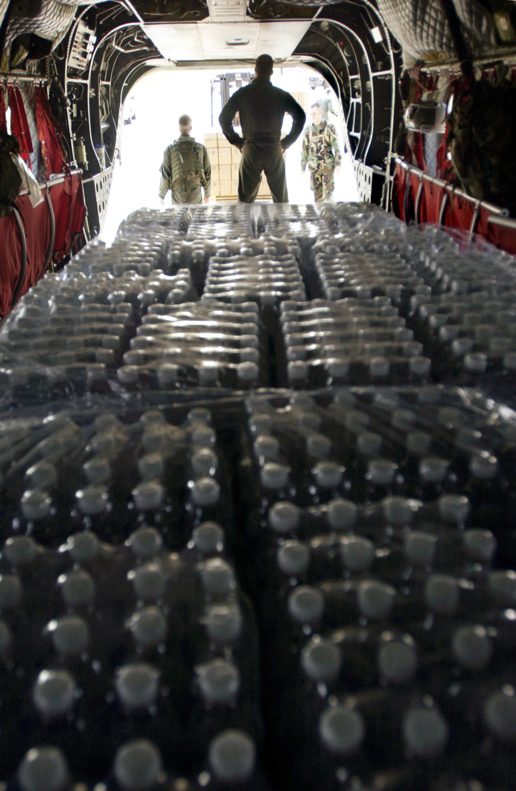 US Army (USA) Sergeant (SGT) Curt Bowlins prepares to offload Meals Ready to Eat (MRE) and bottled water in Liberty, Texas (TX), in support of the Hurricane Rita recovery. SGT Bowlins is a Crew CHIEF with Bravo Company, 5th Battalion, 159th Aviation Regiment (AR), from Fort Eustis, Virginia (VA). (SUBSTANDARD)
