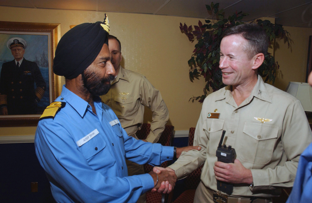 US Navy (USN) Captain (CAPT) Ted Branch (right), Commanding Officer (CO) USS NIMITZ (CVN 68), greets Rear Admiral (RADM) Anup Singh, Indian Navy CHIEF of STAFF, Western Naval Command, during a distinguished visitor embark. The NIMITZ is currently participating in MALABAR '05 off the coast of India