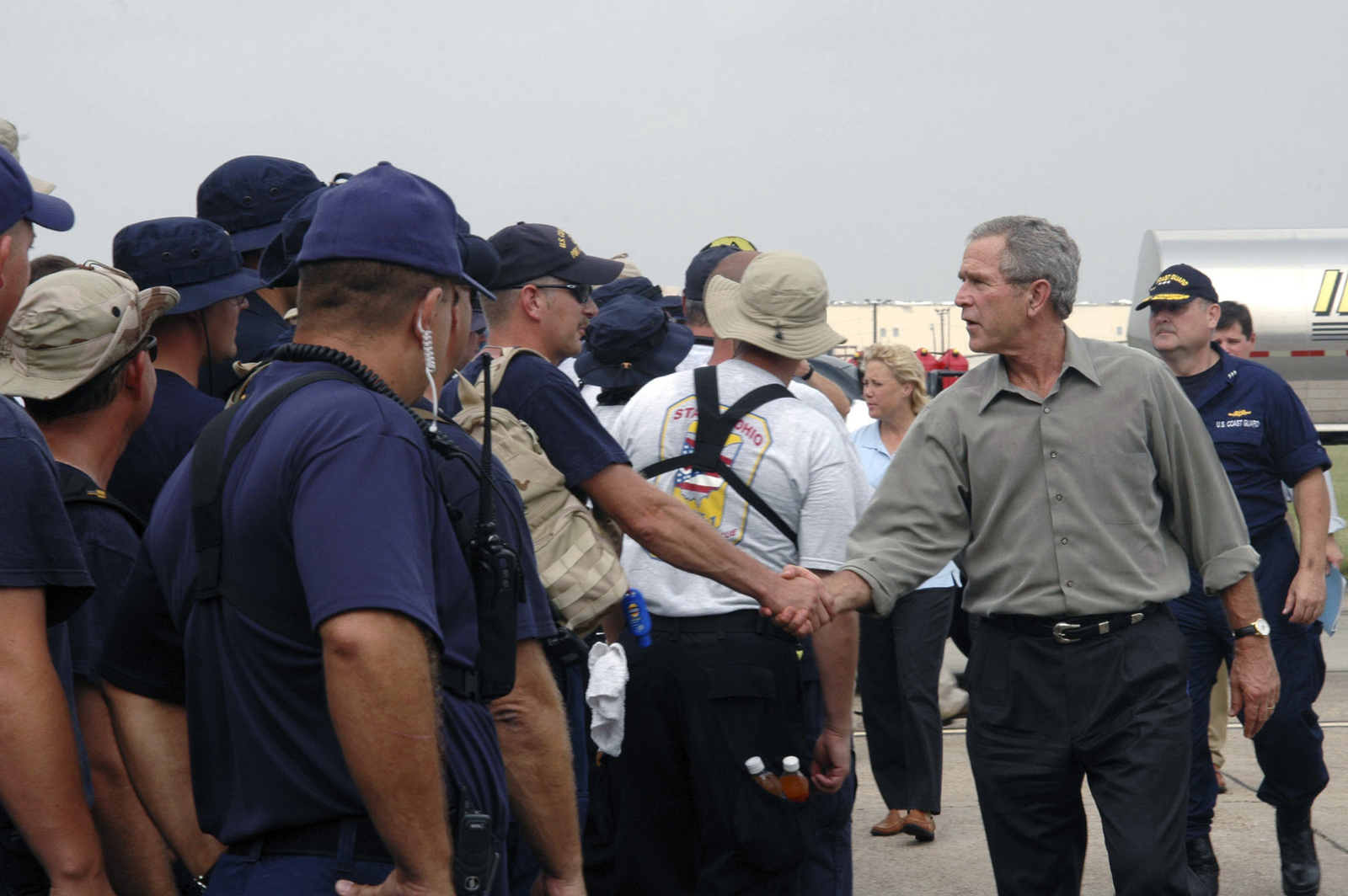 US President George W. Bush visits with US Coast Guard (USCG) and Joint Task Force (JTF) personnel responding to Hurricane Rita at a staging point in Lake Charles, Louisiana (LA). Department of Defense (DoD) units mobilized in support of humanitarian relief operations in the Gulf Coast region. (Duplicate image see also DDSD0605736 or search 050927G0000O001)