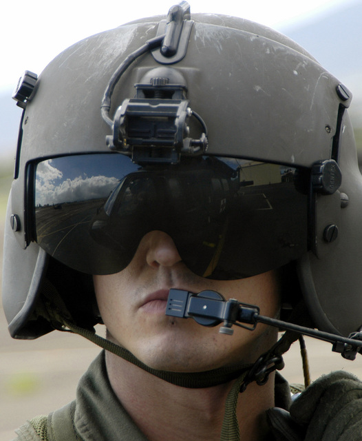 US Army (USA) SPECIALIST Fourth Class (SPC) Eric D. Gould, crewchief, UH-60 Black Hawk (Blackhawk) helicopter, performs a pre-flight check before winch/hoist training at Wheeler Army Airfield (AAF), Hawaii (HI). Soldiers from the 68th Medical Company (Air Ambulance) (MED CO (AA)), 25th Infantry Division (ID) (Light), are helping guide members of JPAC (Joint POW/MIA Accounting Command) through hoist training and familiarization before their next recovery mission to Laos. The JPAC mission is to achieve the fullest possible accounting of all Americans missing as a result of our nation's previous conflicts