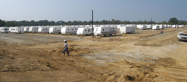[Hurricane Katrina] Baker, LA, September 29, 2005 -- A workman walks across the end of a section of a temporary housing site, which has more than 400 of the 550 travel trailers to be placed here now in place.  This FEMA travel trailer park, one of several to be built at selected locations, will house individuals and families left homeless by Hurricane Katrina.  Win Henderson / FEMA
