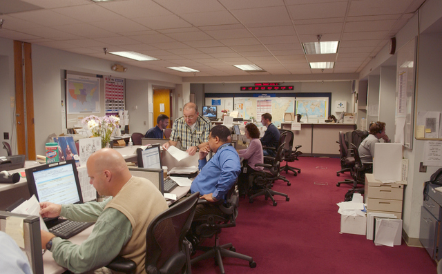 [Hurricane Katrina/Hurricane Rita] Washington, DC, September 29, 2005 -- Disaster workers at the logistics section of the NRCC (National Response Coordination Center) at FEMA headquarters.  The center has been operating on a 24/7 schedule since late August. Bill Koplitz/FEMA