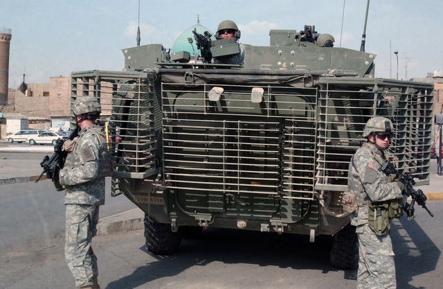 US Army (USA) Soldiers from the 1ST Battalion (BN), 17th Infantry Regiment (IN), 172nd Stryker Brigade Combat Team (SBCT), Fort Wainwright, Alaska (AK), on patrol in Mosul, Iraq, during Operation IRAQI FREEDOM. The 1126 Stryker Infantry Carrier Vehicle (ICV) is fitted with a Slat Armor cage