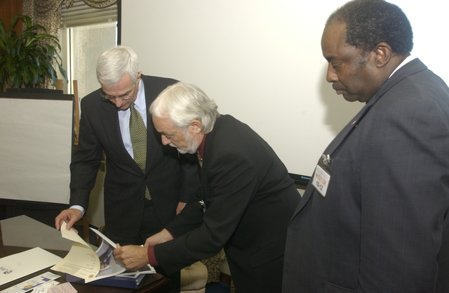Deputy Secretary Roy Bernardi with John Arnold - Deputy Secretary Roy Bernardi being shown briefing materials [by John Arnold, founder and chief executive officer of Portable Practical Educational Preparation, Inc., and member of Latino interests group visiting HUD Headquarters]