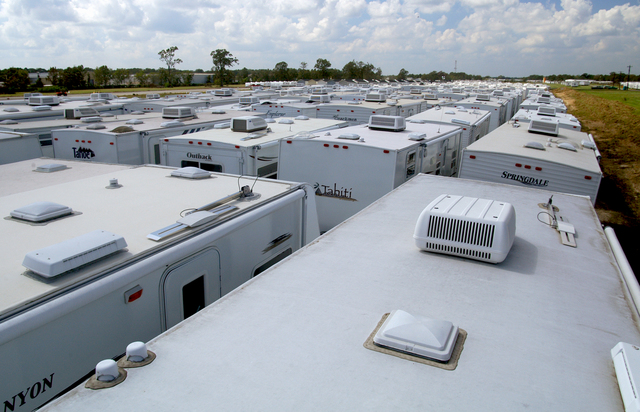 [Hurricane Katrina/Hurricane Rita] Baton Rouge, LA, October 1, 2005 -- A sea of white travel trailer tops stretches out into the horizon at a staging area set up to hold these temporary housing units for inspection and documentation prior to being placed on private sites, in commercial and industrial parks and FEMA-developed group sites throughout the state.  Thousands of residents left homeless by Hurricanes Katrina and Rita will use these FEMA temporary housing resources. Win Henderson / FEMA