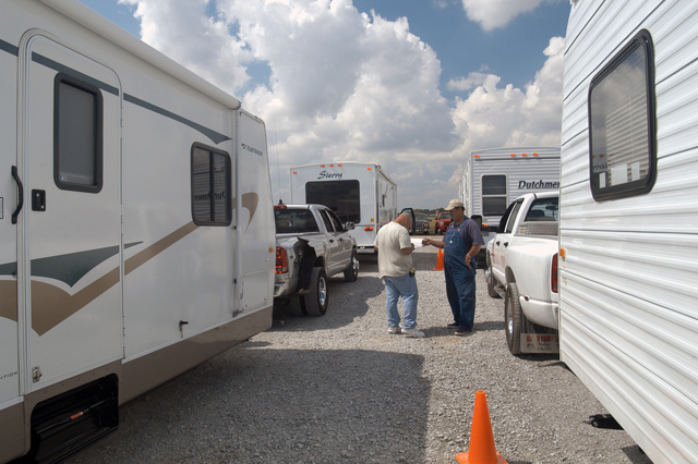 [Hurricane Katrina/Hurricane Rita] Baton Rouge, LA, October 1, 2005 -- Four drivers wait for inspectors to complete the documentation of these travel trailers, the final step taken before they are taken to sites to house either individuals or families left homeless by Hurricanes Katrina and Rita.  Many thousands of these units and mobile homes will be used to provide temporary quarters for residents of the state.  Win Henderson / FEMA