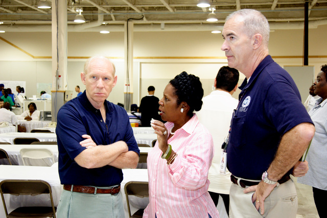 [Hurricane Rita] Houston, TX, October 1, 2005 -- Houston Mayor Bill White, US Congresswoman Sheila Jackson-Lee and FEMA FCO Tom Costello discuss housing issues at the DRC in Houston.  The super DRC comprises Federal, State and local agencies.  Photo by Ed Edahl/FEMA