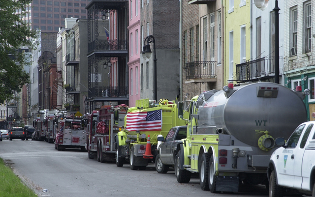 [Hurricane Katrina] New Orleans, LA., October 2, 2005 -- Fire trucks line the street to return to the French Quarter Fire Station. The fire station is currently housing fire fighters from around the county who have come to New Orleans to help with the recovery efforts following Hurricane Katrina.Patricia Brach/FEMA