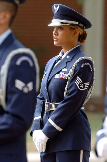 US Air Force (USAF) STAFF Sergeant (SSGT) Julen Stallings (background), Non-Commissioned Officer in Charge (NCOIC), of the Base Honor Guard Team at Charlotte Air National Guard Base (ANGB), North Carolina (NC), stands at ease during a Monument Rededication Ceremony held on Base