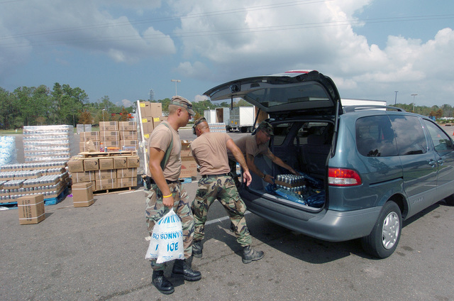 US Army (USA) Soldiers assigned to C Company, 1ST Battalion 111th Infantry, Pennsylvania Army National Guard (PAARNG) load supplies in a residents van at a Point Of Distribution (POD) in Covington, Louisiana (LA), during Hurricane Katrina relief efforts. (A3613)