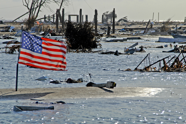 [Hurricane Rita] Holly Beach, La., October 3, 2005 - An American flag, planted on a sandbar that was once a road in this gulfside community of 300 residents, flutters amongst the ruins that remain. Hurricane Rita totally devastated this town which also played host to thousands of tourists and fishermen.  Win Henderson / FEMA