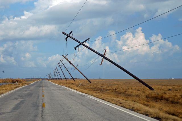 [Hurricane Rita] Holly Beach, La., October 3, 2005 - Power poles lean precipitously along Highway 27 which borders the Gulf of Mexico in lower Cameron Parish.  Thousands of poles are either leaning or fallen due to Hurricane Rita's powerful winds.  Win Henderson / FEMA