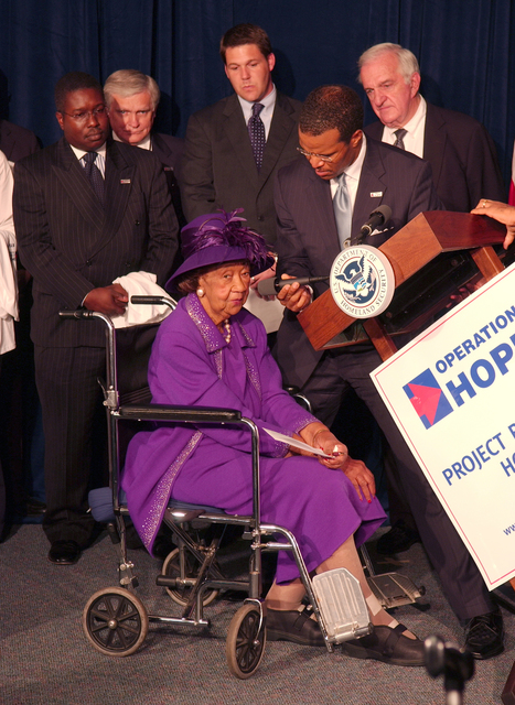 [Hurricane Katrina] Washington, DC, October 4, 2005 -- Dr. Dorothy Height talks about John Bryant, the CIO of Operation HOPE before he presents her with a check that will go towards helping the residents of New Orleans, at FEMA headquarters.  Behind them are the partners of Project Restore Hope who are at the joint press conference to announce plans to help the evacuees from New Orleans. Bill Koplitz/FEMA