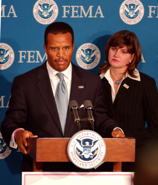 Washington, DC, October 4, 2005 -- John Bryant, Founder, Chairman & CEO of Operation HOPE, Inc. at a joint press conference for Project Restore HOPE at FEMA headquarters.  Behind him is Desiree Sayle, Deputy Assistant to the President & Director, USA Freedom Corps, White House. Bill Koplitz/FEMA