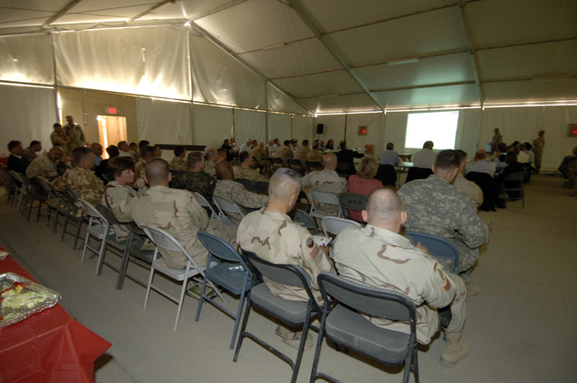 A view of the participants of the NATO convention at Kandahar Airfield, Afghanistan, Oct. 6, 2005. The purpose of the convention is to review the historic National Assembly Elections, the role ISAF (International Security Asisitance Forces) play in helping to bring about success and receive briefings on exceptional funding to support Deployed Operating Bases. (U.S. Army PHOTO by PFC. Leslie Angulo) (Released)