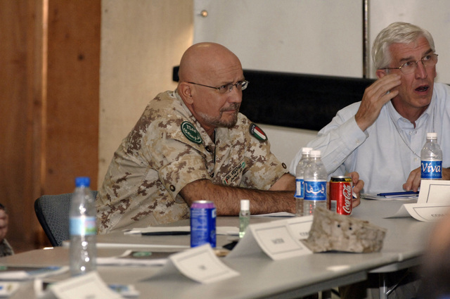 Italian Army LT.Gen Mauro Del Vecchio (center) pays close attention to the opening remarks of LT.Gen Eikenberry during a NATO convention at Kandahar Airfield, Afghanistan, Oct. 6, 2005. The purpose of the convention is to review the historic National Assembly Elections, the role ISAF (International Security Asisitance Forces) play in helping to bring about success and receive briefings on exceptional funding to support Deployed Operating Bases. (U.S. Army PHOTO by PFC. Leslie Angulo) (Released)