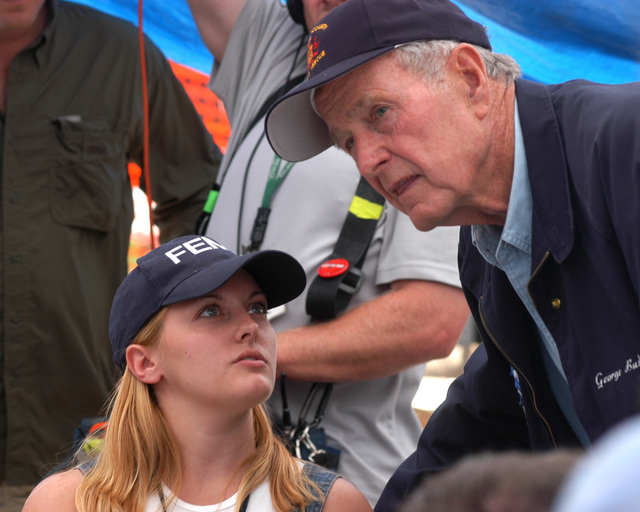 [Hurricane Katrina] Hancock County, Miss., September 8, 2005 -- Former President George H. W. Bush speaks with FEMA representative Meredith Chandler during his visit to the Waveland Disaster Recovery Center (DRC).  President Bush is touring the Mississippi and Louisiana gulf coasts to see the damage caused by Hurricane Katrina and the ongoing recovery efforts.  FEMA/Mark Wolfe
