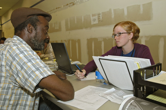 """[Hurricane Katrina] LaPlace, La., October 8, 2005 - Ashley Kusick (right), a high school teacher left without a job when Hurricane Katrina hit New Orleans, has been hired by FEMA and is now in training to become a Disaster Recovery Center manager at the LaPlace DRC at 160 Belle Terre; her old school, Landry High School in New Orleans, is also now a DRC.  Ashley is a member of the """"Teach For America"""" program that secures employment for new teachers in inner city schools around the nation.  Win Henderson / FEMA"""