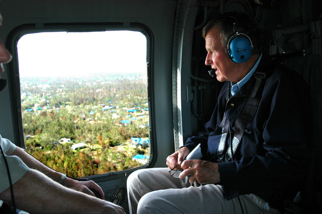 [Hurricane Katrina] September 8, 2005 -- Former President George H. W. Bush on a helicopter tour of the Mississippi and Louisiana gulf coast.  President Bush is on a tour to see the damage caused by Hurricane Katrina and the ongoing recovery efforts.  FEMA/Mark Wolfe