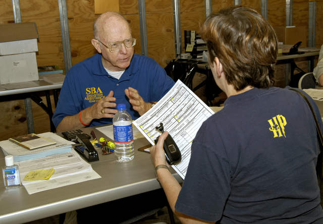 [Hurricane Katrina/Hurricane Rita] LaPlace, La., October 8, 2005 - A representative of the U.S. Small Business Administration, part of the staff of disaster agency workers now serving applicants at the Disaster Recovery Center, 160 Belle Terre, goes over the details of the low-interest disaster loans that are available to homeowners and renters for damages and losses caused by Hurricanes Katrina and Rita.  The SBA is but one of the many agencies that meet one-on-one with applicants for disaster assistance at 30 DRC's presently operating throughout the state.  Win Henderson / FEMA