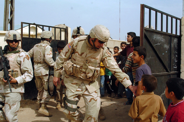 MAJ. GEN. David Rodriguez, Commander of Multi National Brigade- Northwest (Task Force Freedom) greets some young kids while checking out some polling sites to make sure they are ready for the up coming elections in Mosul, Iraq on Oct. 11, 2005. Multi National Brigade- Northwest is in Iraq in support of Operation Iraqi Freedom.(U.S. Army photo By SPC. Jory C. Randall) (Released)