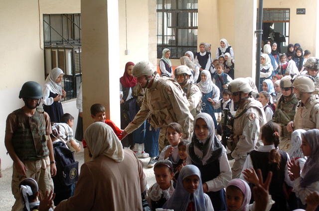 MAJ. GEN. David Rodriguez, Commander of Multi-National Brigade- Northwest (Task Force Freedom) shakes hands with a young boy, while checking out some polling sites to make sure they are ready for the upcoming elections in Mosul, Iraq on Oct. 11, 2005. Multi National Brigade- Northwest is in Iraq in support of Operation Iraqi Freedom.(U.S. Army photo By SPC. Jory C. Randall) (Released)