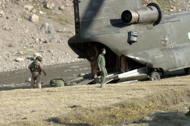 A U.S. Army CH-47 Chinook helicopter crew offloads cargo at a landing zone in Northern Pakistan Oct. 12, 2005. The U.S. Army is delivering disaster relief supplies and services as part of a multinational effort to provide aid and support to Pakistan and parts of India and Afghanistan following a devastating earthquake.  (U.S. Army photo by SPC. Christopher Admire) (Released)