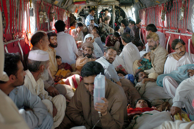Injured Pakistani civilians sit in the cabin of a US Army (USA) CH-47 Chinook helicopter during a transport flight to the Pakistan Air Force (PAF) base in Chaklala, Pakistan for medical treatment. The United States government is participating in a multinational humanitarian assistance and support effort lead by the Pakistani Government to bring aid to victims of the devastating earthquake that struck the region