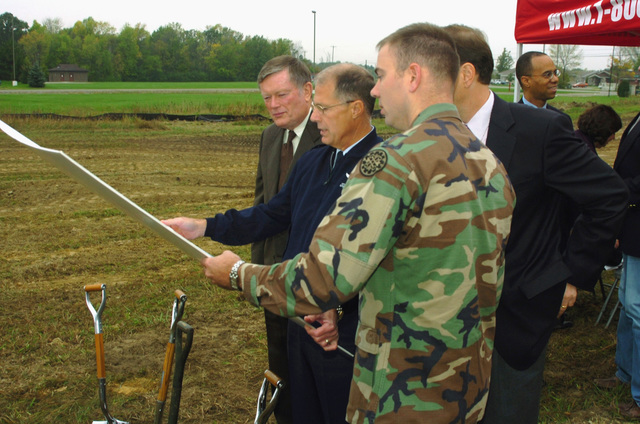 Representative Richard Ball (background) (R-MI), Michigan (MI) State Representative District 5; Major General (MGEN) Thomas G. Cutler, Adjutant General for the State of Michigan; US Congressman Dave Camp; and Michigan Army National Guard (MIARNG) Captain (CPT) Middaugh (foreground), look over the plans for the new Shiawasee Readiness Center being built for 144th Military Police Company (MP CO), Michigan Army National Guard (MIARNG)