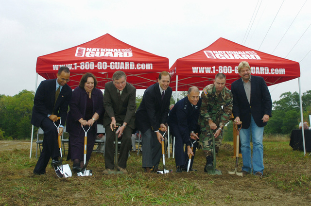 Stuart Pigler (left) (Congressman Rogers office), Connie Feuerstein (Debbie Stabenow's office), Richard Ball (Michigan Representative District 5), US Congressman Dave Camp, Major General (MGEN) Thomas G. Cutler (Adjutant General for the State of Michigan), Michigan Army National Guard (MIARNG) Captain (CPT) Middaugh, and Stephen Corey (right) (Mayor of Corunna) break ground at the Michigan National Guard Shiawassee Readiness Center in Corunna, Michigan (MI). The Center will house the 144th Military Police Company (MP CO), Michigan Army National Guard (MIARNG)