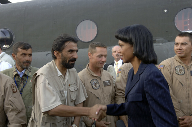 U.S. Secretary of State Dr. Condoleezza Rice shakes hands with a civilian disaster relief worker during her visit to Islamabad, Pakistan, International Airport Oct. 12, 2005. The Department of Defense is participating in the multinational effort to provide humanitarian assistance and support to Pakistan and parts of India and Afghanistan following a devastating earthquake. (U.S. Army photo by SPC. Christopher Admire) (Released)
