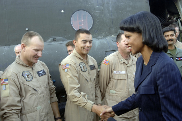 U.S. Secretary of State Dr. Condoleezza Rice shakes hands with U.S. Army STAFF Sargeant Jorge Cortez during her visit to Islamabad, Pakistan, International Airport Oct. 12, 2005. The Department of Defense is participating in the multinational effort to provide humanitarian assistance and support to Pakistan and parts of India and Afghanistan following a devastating earthquake. (U.S. Army photo by SPC. Christopher Admire) (Released)