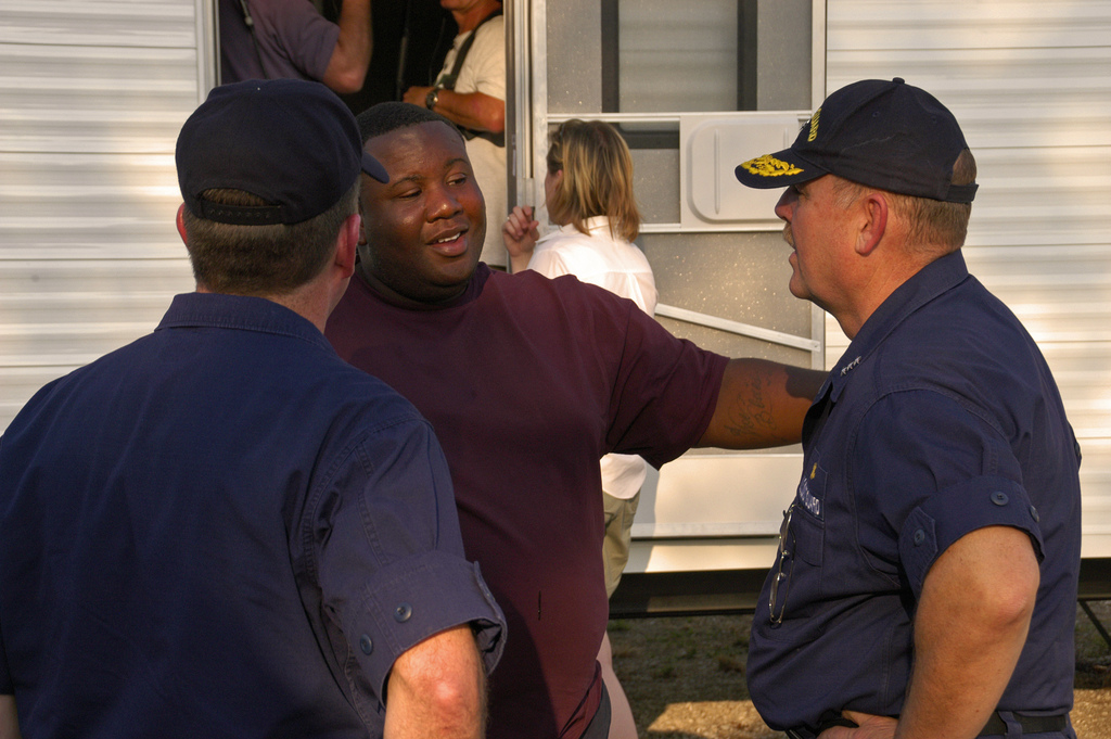 [Hurricane Katrina/Hurricane Rita] Baton Rouge, LA, 10-15-05 -- Vice-Admiral Thad Allen greets New Orleans evacuee Isaac Ray at the Baton Rouge Victory Trailer Park. Isaac Ray lost his home to Hurricane Kitrina and he and his family are the first to move into the Baton Rouge Victory Road Trailer Park. Trailer Parks are one form of housing being used to provide shelter for people displaced by Hurricanes Kitrina & Rita.  MARVIN NAUMAN/FEMA photo