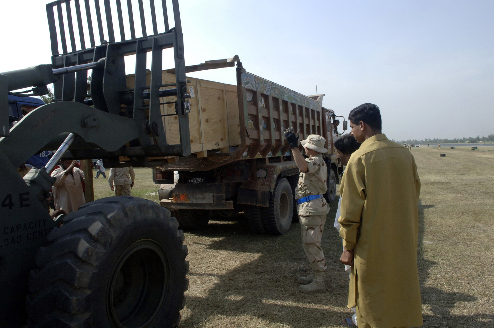 U.S. Air Force ground crews help load up a civilian cargo truck in Islamabad, Pakistan, with earthquake relief supplies for overland transport to areas in Pakistan Oct. 14, 2005. The Department of Defense is participating in the multinational effort to provide humanitarian assistance and support to Pakistan and parts of India and Afghanistan following a devastating earthquake. (U.S. Army photo by SPC. Christopher Admire) (Released)